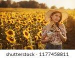 cute brunette in a blossoming... | Shutterstock . vector #1177458811