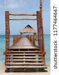pier and thatched hut on the... | Shutterstock . vector #1177464667