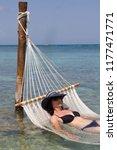 woman lying on a hammock which... | Shutterstock . vector #1177471771