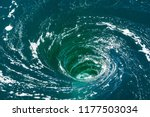Small photo of A powerful whirlpool is generated at the surface of the green waters of the river Rance by the action of a turbine of the tidal power station near Saint-Malo in Brittany, France.