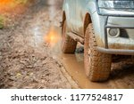 car tire on dirt road with the... | Shutterstock . vector #1177524817