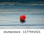 raspberry on wooden table. | Shutterstock . vector #1177541521