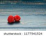 raspberry on wooden table. | Shutterstock . vector #1177541524