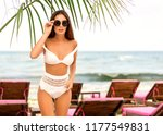 girl lies on a tropical beach... | Shutterstock . vector #1177549831