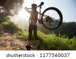 young woman cyclist carrying... | Shutterstock . vector #1177560037