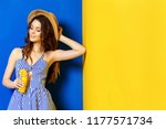young woman in blue sarafan...   Shutterstock . vector #1177571734