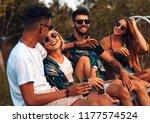 group of young friends enjoying ... | Shutterstock . vector #1177574524
