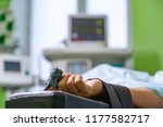 patients hand with a sensor on... | Shutterstock . vector #1177582717
