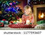 happy little girl wearing... | Shutterstock . vector #1177593607