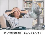 Woman Suffers From Heat While...