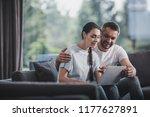 happy man embracing girlfriend... | Shutterstock . vector #1177627891