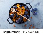 cast iron pot full of plums... | Shutterstock . vector #1177634131