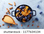 cast iron pot full of plums... | Shutterstock . vector #1177634134