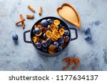 cast iron pot full of plums... | Shutterstock . vector #1177634137