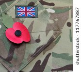 Poppy on a British army uniform background