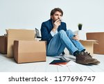 a man is sitting on the floor... | Shutterstock . vector #1177696747