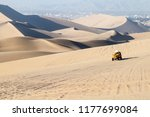 dune buggy rides the sand dunes ...   Shutterstock . vector #1177699084