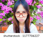 a women wearing red glasses and ...   Shutterstock . vector #1177706227