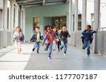 elementary school kids running... | Shutterstock . vector #1177707187