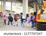 Small photo of Elementary school kids arrive at school from the school bus