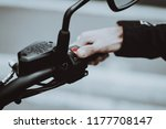 hand of a biker laying on... | Shutterstock . vector #1177708147