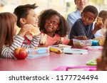young school kids eating lunch... | Shutterstock . vector #1177724494