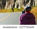 Biker Photographer In Raincoat...