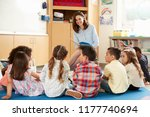 school kids sitting on floor in ... | Shutterstock . vector #1177740694