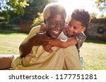 senior black man sitting on... | Shutterstock . vector #1177751281