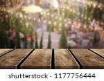 wood table on blur background... | Shutterstock . vector #1177756444