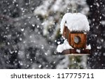 A Snow Covered Bird House In...