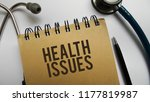 health issues memo written on a ... | Shutterstock . vector #1177819987