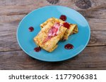 pancakes served with cream and... | Shutterstock . vector #1177906381