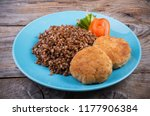 buckwheat porridge served with... | Shutterstock . vector #1177906384