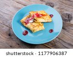 pancakes served with cream and... | Shutterstock . vector #1177906387