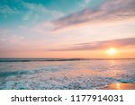 pink sunset sea with surfers. ... | Shutterstock . vector #1177914031