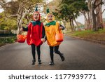 cute little girls in halloween... | Shutterstock . vector #1177939771