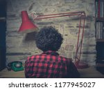 young hipster man working in... | Shutterstock . vector #1177945027