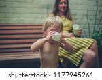 a young mother and her toddler... | Shutterstock . vector #1177945261