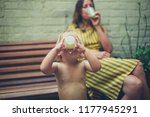 a young mother and her toddler... | Shutterstock . vector #1177945291