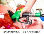 man holding pump and refueling... | Shutterstock . vector #1177969864