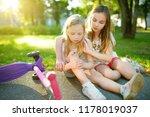 adorable girl comforting her... | Shutterstock . vector #1178019037