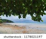 tropical beach under gloomy sky.... | Shutterstock . vector #1178021197