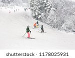 downhill skiing during a heavy... | Shutterstock . vector #1178025931