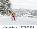 the skier begins descent. a... | Shutterstock . vector #1178025934