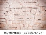 the wall of uneven bricks is...