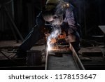 Small photo of Welding with sparks by Process fluxed cored arc welding ,Industrial steel welder part in factory welder Industrial automotive part in factory.