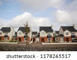 identical tricolor cottages in... | Shutterstock . vector #1178265517