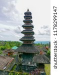 Small photo of Cloudy Pura Besakih Temple in Bali, Indonesia. Swastika is an ancient Indian Hindu icon in the Indonesian culture.