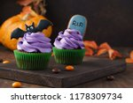 Stock photo festive halloween cupcakes decorated with gingerbread cookies tombstone and bat dark background 1178309734